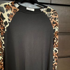 Black long sleeve top with leopard sleeves